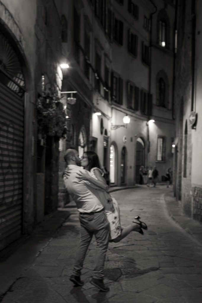 a kiss in the streets of Florence by night