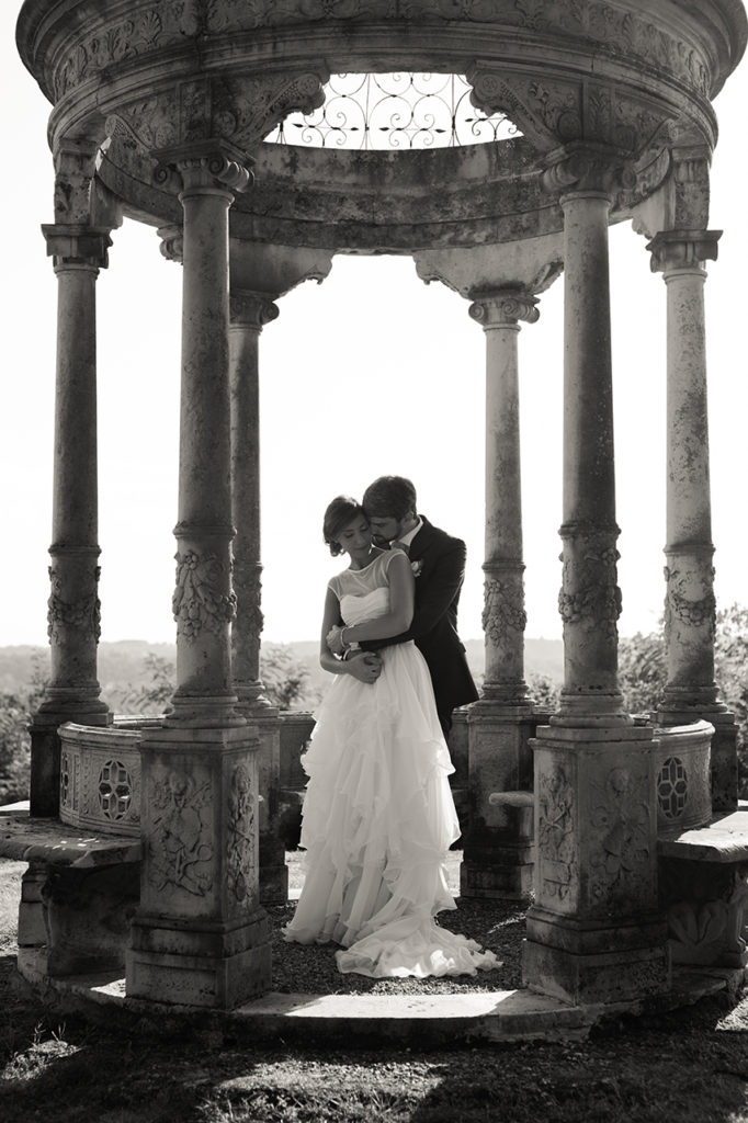 a place to stay closer, a couple kissing in their wedding day.