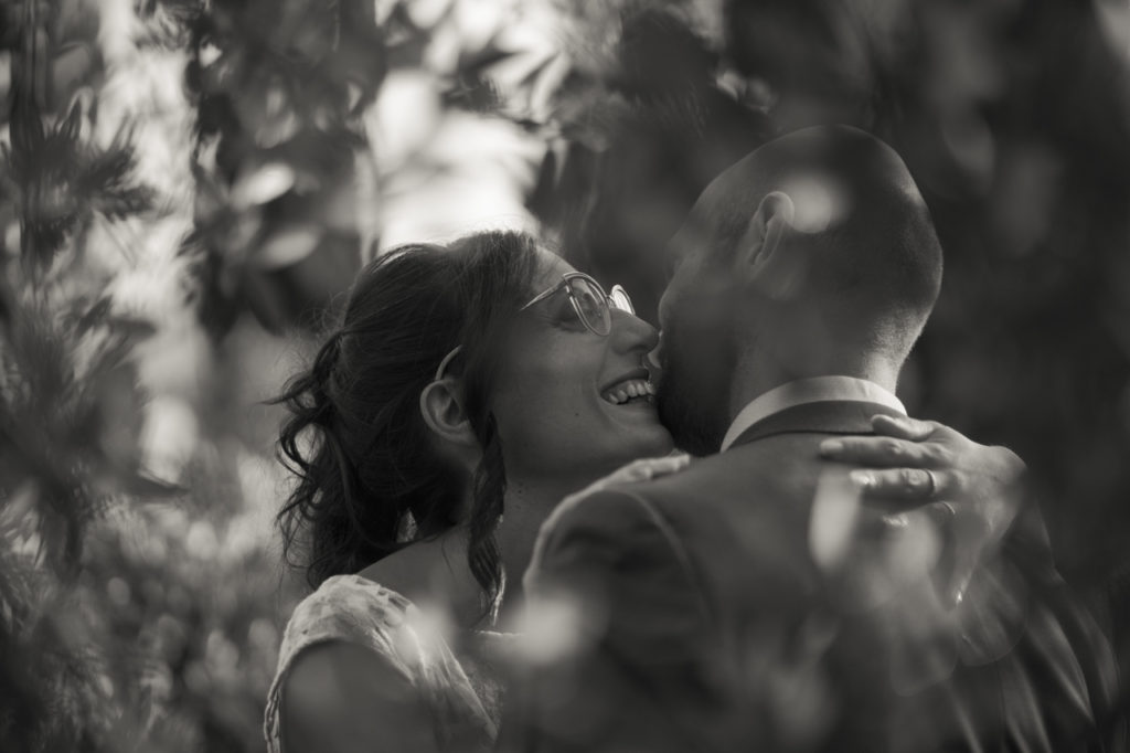 her smile, a bride smiling next to the groom in their intimacy